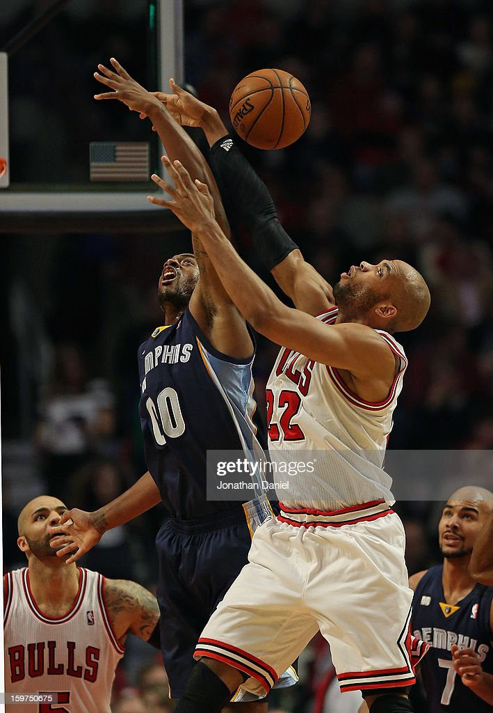 Taj Gibson #20 of the Chicago Bulls battles for a rebound with Darrell Arthur #00 of the Memphis Grizzles at the United Center on January 19, 2013 in Chicago, Illinois. The Grizzlies defeated the Bulls 85-82 in overtime.