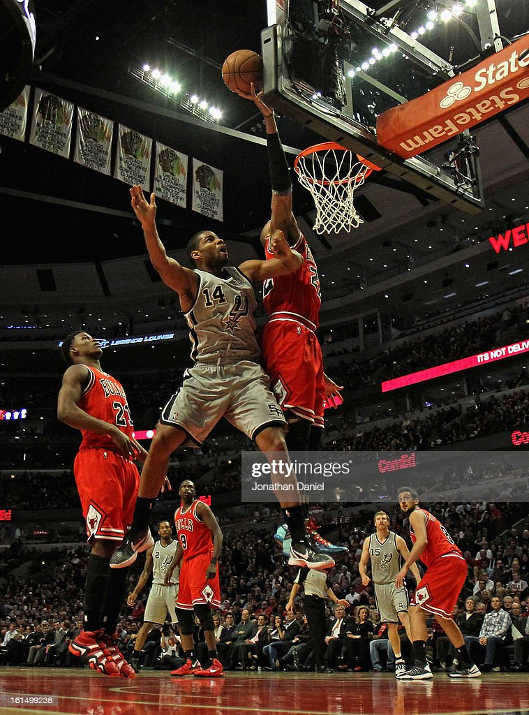 <a gi-track='captionPersonalityLinkClicked' href=/galleries/search?phrase=Taj+Gibson&family=editorial&specificpeople=4029461 ng-click='$event.stopPropagation()'>Taj Gibson</a> #22 of the Chicago Bulls blocks a shot by <a gi-track='captionPersonalityLinkClicked' href=/galleries/search?phrase=Gary+Neal&family=editorial&specificpeople=5085165 ng-click='$event.stopPropagation()'>Gary Neal</a> #14 of the San Antonio Spurs at the United Center on February 11, 2013 in Chicago, Illinois. The Spurs defeated the Bulls 103-89.