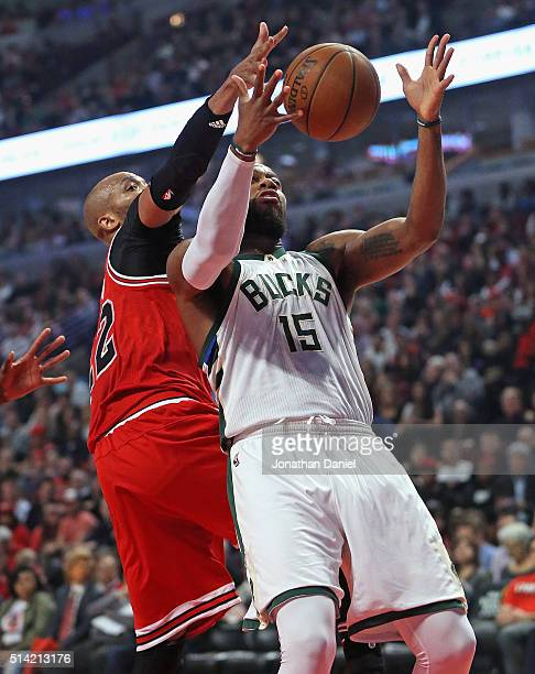 Taj Gibson of the Chicago Bulls blocks a shot by Greg Monroe of the Milwaukee Bucks at the United Center on March 7 2016 in Chicago Illinois NOTE TO...
