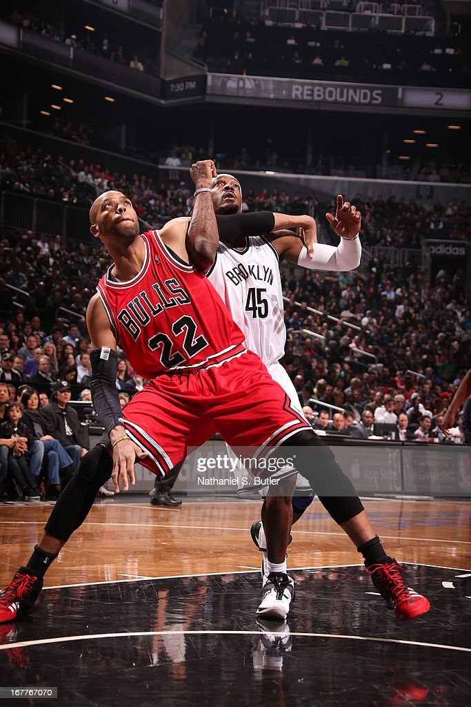 Taj Gibson #22 of the Chicago Bulls boxes out Gerald Wallace #45 of the Brooklyn Nets in Game Five of the Eastern Conference Quarterfinals during the 2013 NBA Playoffs on April 29 at the Barclays Center in the Brooklyn borough of New York City.