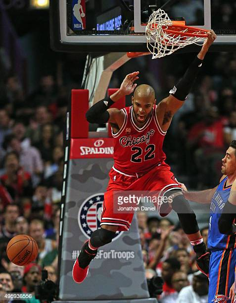 Taj Gibson of the Chicago Bulls celebrates a dunk against the Oklahoma City Thunder at the United Center on November 5 2015 in Chicago Illinois The...