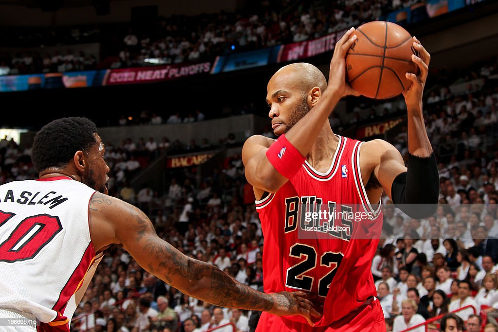<a gi-track='captionPersonalityLinkClicked' href=/galleries/search?phrase=Taj+Gibson&family=editorial&specificpeople=4029461 ng-click='$event.stopPropagation()'>Taj Gibson</a> #22 of the Chicago Bulls controls the ball against <a gi-track='captionPersonalityLinkClicked' href=/galleries/search?phrase=Udonis+Haslem&family=editorial&specificpeople=201748 ng-click='$event.stopPropagation()'>Udonis Haslem</a> #40 of the Miami Heat in Game Two of the Eastern Conference Semifinals during the 2013 NBA Playoffs on May 8, 2013 at American Airlines Arena in Miami, Florida.