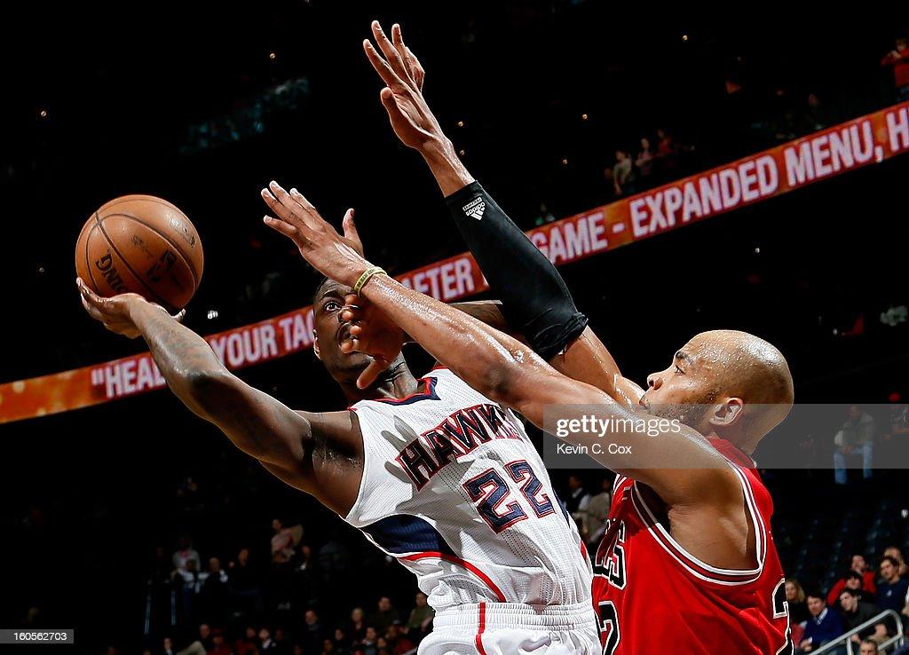 Taj Gibson #22 of the Chicago Bulls defends against Anthony Morrow #22 of the Atlanta Hawks at Philips Arena on February 2, 2013 in Atlanta, Georgia.