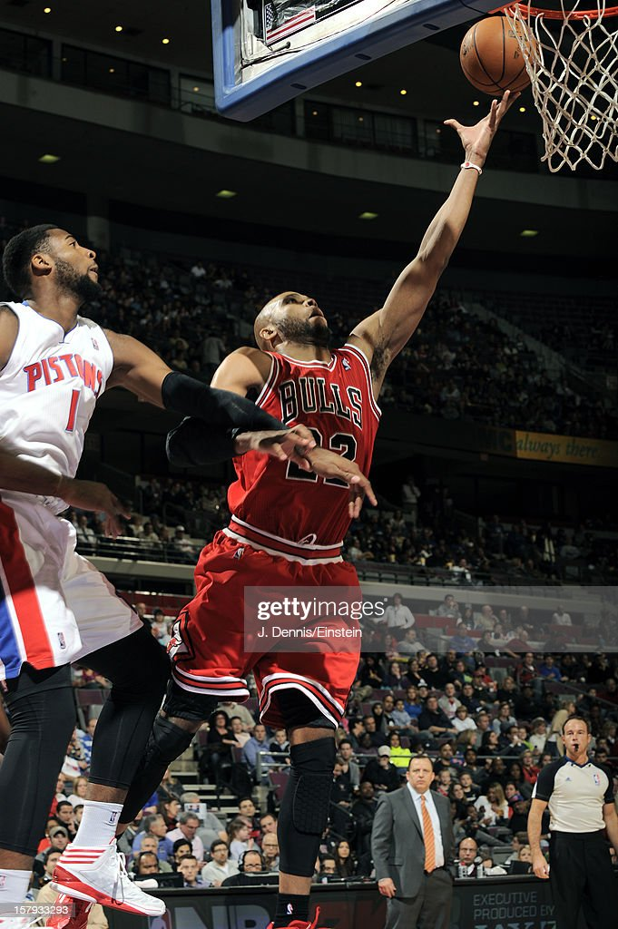 Taj Gibson #22 of the Chicago Bulls drives to the basket against Andre Drummond #1 of the Detroit Pistons on December 7, 2012 at The Palace of Auburn Hills in Auburn Hills, Michigan.