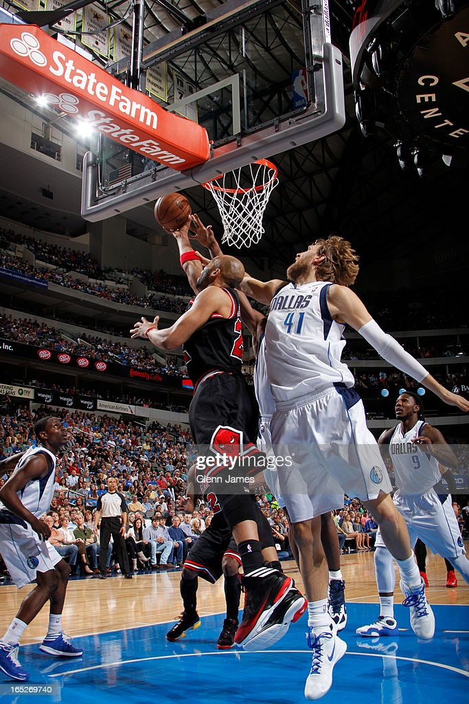 <a gi-track='captionPersonalityLinkClicked' href=/galleries/search?phrase=Taj+Gibson&family=editorial&specificpeople=4029461 ng-click='$event.stopPropagation()'>Taj Gibson</a> #22 of the Chicago Bulls drives to the basket against the Dallas Mavericks on March 30, 2013 at the American Airlines Center in Dallas, Texas.