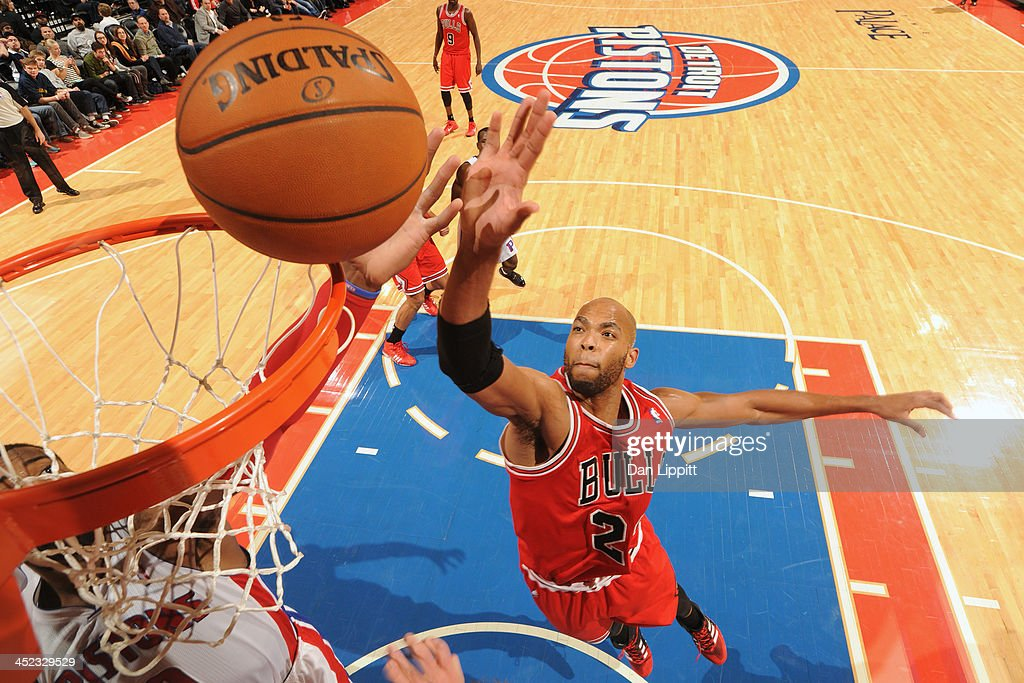 Taj Gibson #22 of the Chicago Bulls drives to the basket against the Detroit Pistons on November 27, 2013 at The Palace of Auburn Hills in Auburn Hills, Michigan.