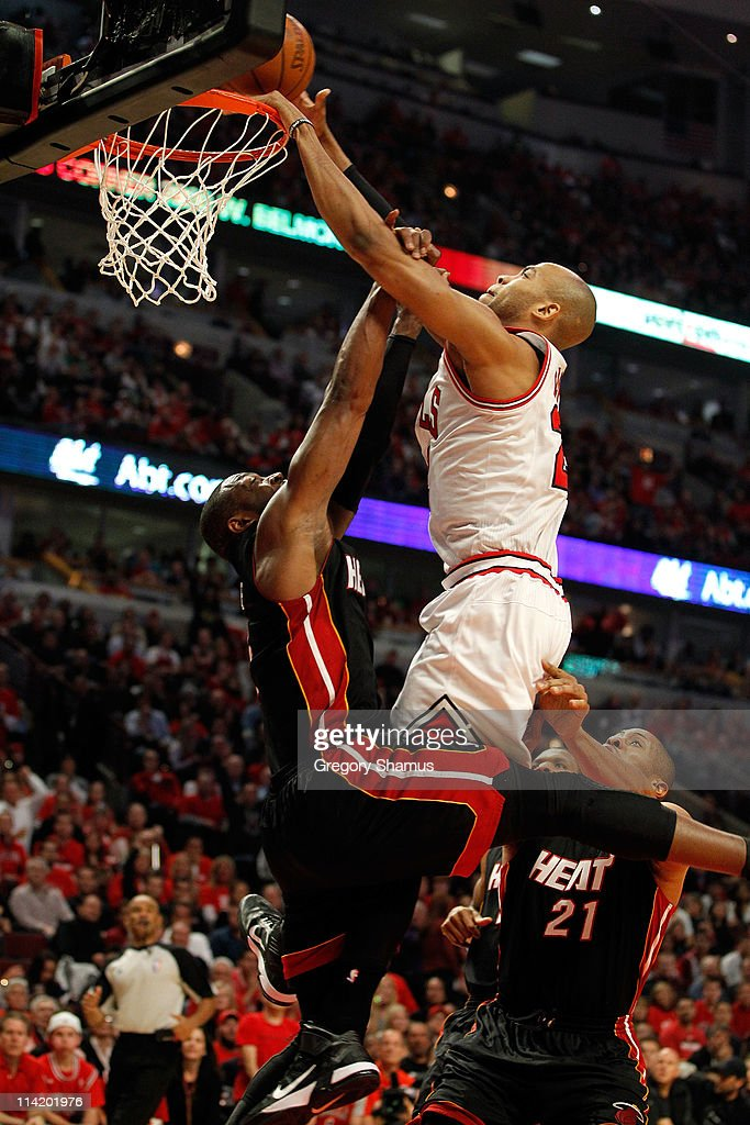 Taj Gibson #22 of the Chicago Bulls dunks against Dwyane Wade #3 of the Miami Heat in Game One of the Eastern Conference Finals during the 2011 NBA Playoffs on May 15, 2011 at the United Center in Chicago, Illinois.