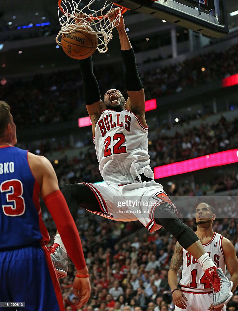 <a gi-track='captionPersonalityLinkClicked' href=/galleries/search?phrase=Taj+Gibson&family=editorial&specificpeople=4029461 ng-click='$event.stopPropagation()'>Taj Gibson</a> #22 of the Chicago Bulls dunks against the Detroit Pistons at the United Center on April 11, 2014 in Chicago, Illinois. The Bulls defeated the Pistons 106-98.