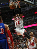 Taj Gibson of the Chicago Bulls dunks against the Detroit Pistons at the United Center on April 11 2014 in Chicago Illinois The Bulls defeated the...