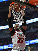 Taj Gibson of the Chicago Bulls dunks against the Los Angeles Clippers at the United Center on December 10 2015 in Chicago Illinois The Bulls...