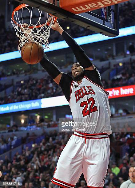 Taj Gibson of the Chicago Bulls dunks against the Sacramento Kings at the United Center on March 21 2016 in Chicago Illinois The Bulls defeated the...