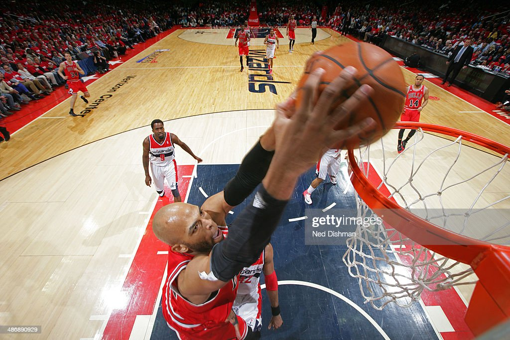 <a gi-track='captionPersonalityLinkClicked' href=/galleries/search?phrase=Taj+Gibson&family=editorial&specificpeople=4029461 ng-click='$event.stopPropagation()'>Taj Gibson</a> #22 of the Chicago Bulls dunks against the Washington Wizards in Game Three of the Eastern Conference Quarterfinals during the 2014 NBA Playoffs at the Verizon Center on April 25, 2014 in Washington, DC.
