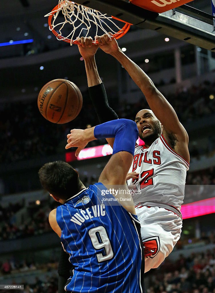 <a gi-track='captionPersonalityLinkClicked' href=/galleries/search?phrase=Taj+Gibson&family=editorial&specificpeople=4029461 ng-click='$event.stopPropagation()'>Taj Gibson</a> #22 of the Chicago Bulls dunks over Nikola Vucevic #9 of the Orlando Magic at the United Center on December 16, 2013 in Chicago, Illinois. The Magic defeated the Bulls 83-82.
