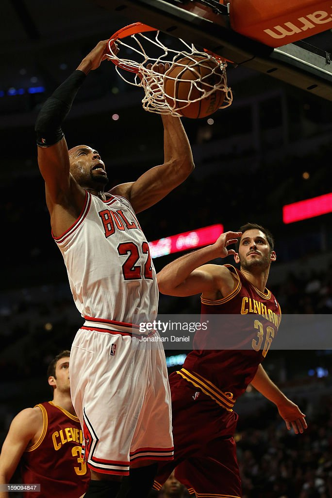 <a gi-track='captionPersonalityLinkClicked' href=/galleries/search?phrase=Taj+Gibson&family=editorial&specificpeople=4029461 ng-click='$event.stopPropagation()'>Taj Gibson</a> #22 of the Chicago Bulls dunks over Omir Casspi #36 of the Cleveland Cavaliers at the United Center on January 7, 2013 in Chicago, Illinois. The Bulls defeated the Cavaliers 118-92.