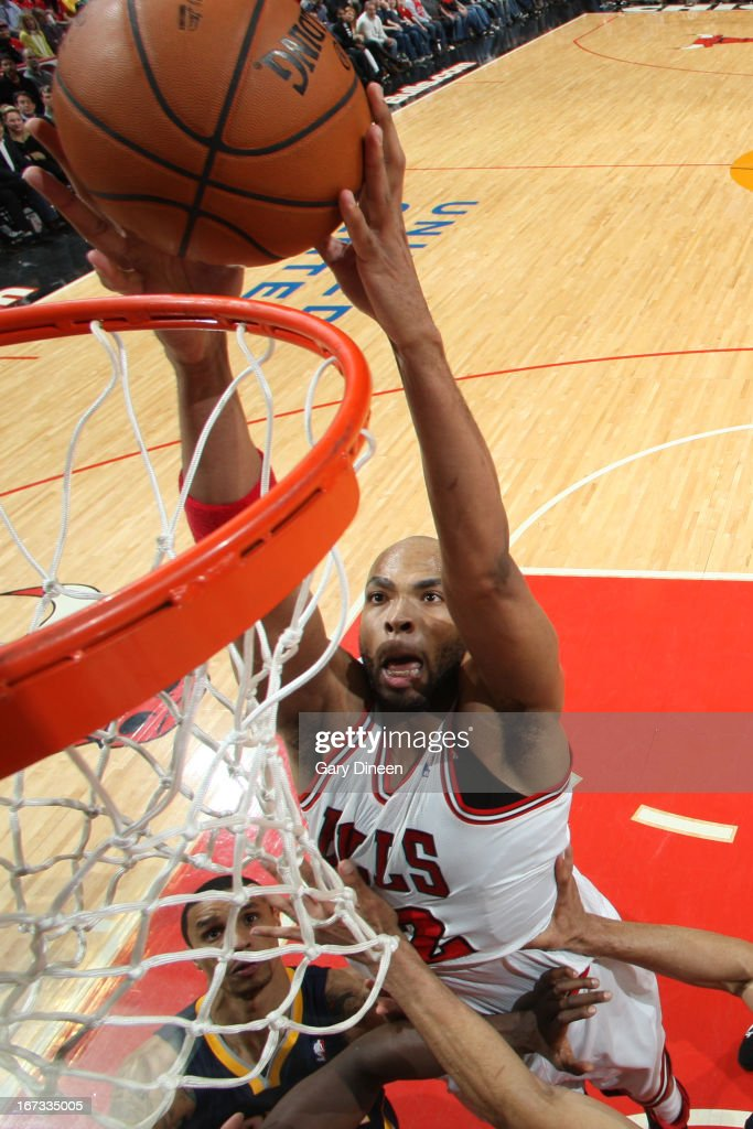 Taj Gibson #22 of the Chicago Bulls dunks the ball against the Indiana Pacers on March 23, 2013 at the United Center in Chicago, Illinois.