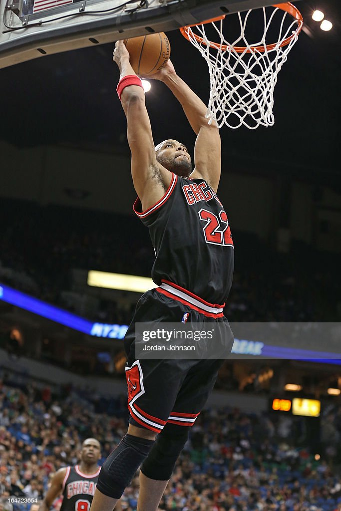 <a gi-track='captionPersonalityLinkClicked' href=/galleries/search?phrase=Taj+Gibson&family=editorial&specificpeople=4029461 ng-click='$event.stopPropagation()'>Taj Gibson</a> #22 of the Chicago Bulls dunks the ball against the Minnesota Timberwolves on March 24, 2013 at Target Center in Minneapolis, Minnesota.