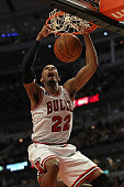 Taj Gibson of the Chicago Bulls dunks the ball against the New Orleans Hornets at the United Center on March 7 2011 in Chicago Illinois The Bulls...