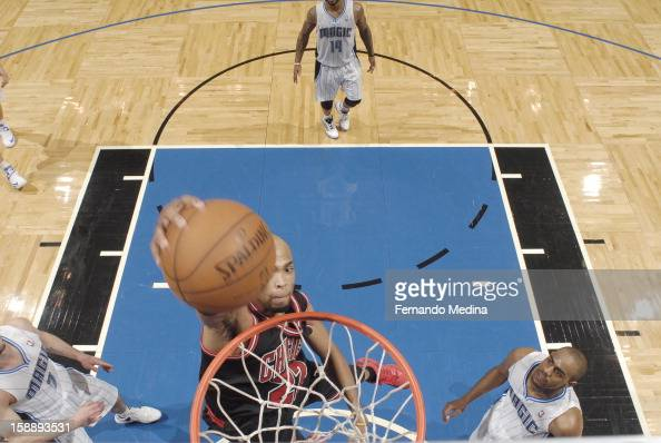 Taj Gibson of the Chicago Bulls dunks the ball during the game between the Chicago Bulls and the Orlando Magic on January 2 2013 at Amway Center in...