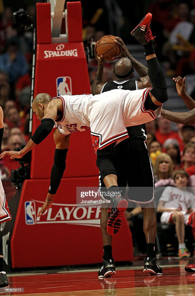 <a gi-track='captionPersonalityLinkClicked' href=/galleries/search?phrase=Taj+Gibson&family=editorial&specificpeople=4029461 ng-click='$event.stopPropagation()'>Taj Gibson</a> #22 of the Chicago Bulls falls over <a gi-track='captionPersonalityLinkClicked' href=/galleries/search?phrase=Reggie+Evans&family=editorial&specificpeople=202254 ng-click='$event.stopPropagation()'>Reggie Evans</a> #30 of the Brooklyn Nets in Game Five of the Eastern Conference Quarterfinals in the 2013 NBA Playoffs at the United Center on April 27, 2013 in Chicago, Illinois. The Bulls defeated the Nets 142-134 in triple overtime.