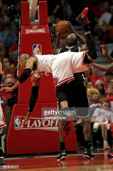 Taj Gibson of the Chicago Bulls falls over Reggie Evans of the Brooklyn Nets in Game Five of the Eastern Conference Quarterfinals in the 2013 NBA...