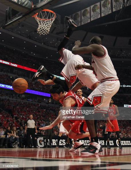 Taj Gibson of the Chicago Bulls falls over Zaza Pachulia of the Atlanta Hawks in Game Five of the Eastern Conference Semifinals in the 2011 NBA...
