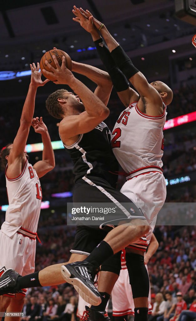 Taj Gibson of the Chicago Bulls fouls Brook Lopez of the Brooklyn Nets in Game Six of the Eastern Conference Quarterfinals during the 2013 NBA...