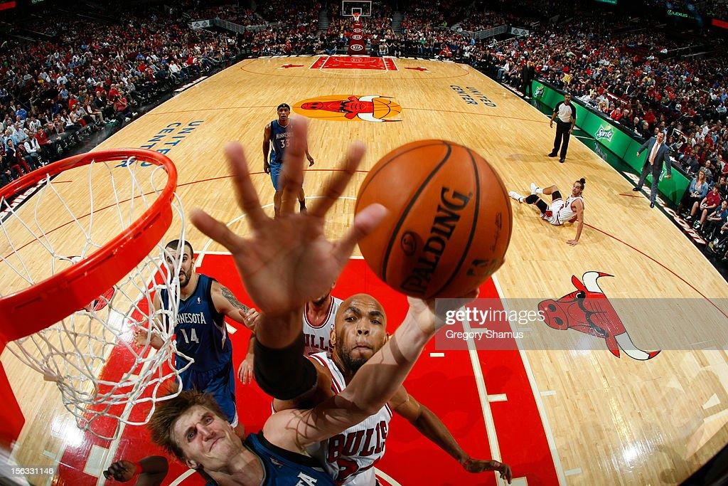 Taj Gibson #22 of the Chicago Bulls goes for a block against Andrei Kirilenko #47 of the Minnesota Timberwolves on November 10, 2012 at the United Center in Chicago, Illinois.