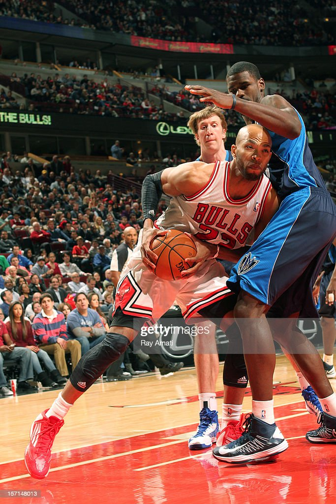 Taj Gibson #22 of the Chicago Bulls goes to the basket against Bernard James #5 of the Dallas Mavericks on November 28, 2012 at the United Center in Chicago, Illinois.