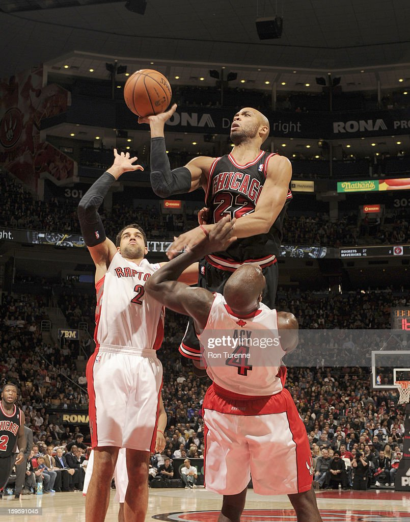 <a gi-track='captionPersonalityLinkClicked' href=/galleries/search?phrase=Taj+Gibson&family=editorial&specificpeople=4029461 ng-click='$event.stopPropagation()'>Taj Gibson</a> #22 of the Chicago Bulls goes to the basket against double defense during the game between the Toronto Raptors and the Chicago Bulls on January 16, 2013 at the Air Canada Centre in Toronto, Ontario, Canada.