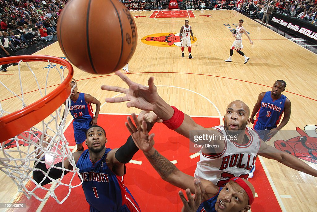 <a gi-track='captionPersonalityLinkClicked' href=/galleries/search?phrase=Taj+Gibson&family=editorial&specificpeople=4029461 ng-click='$event.stopPropagation()'>Taj Gibson</a> #22 of the Chicago Bulls goes to the basket over <a gi-track='captionPersonalityLinkClicked' href=/galleries/search?phrase=Andre+Drummond&family=editorial&specificpeople=7122456 ng-click='$event.stopPropagation()'>Andre Drummond</a> #1 and <a gi-track='captionPersonalityLinkClicked' href=/galleries/search?phrase=Charlie+Villanueva&family=editorial&specificpeople=215189 ng-click='$event.stopPropagation()'>Charlie Villanueva</a> #31 of the Detroit Pistons on March 31, 2013 at the United Center in Chicago, Illinois.