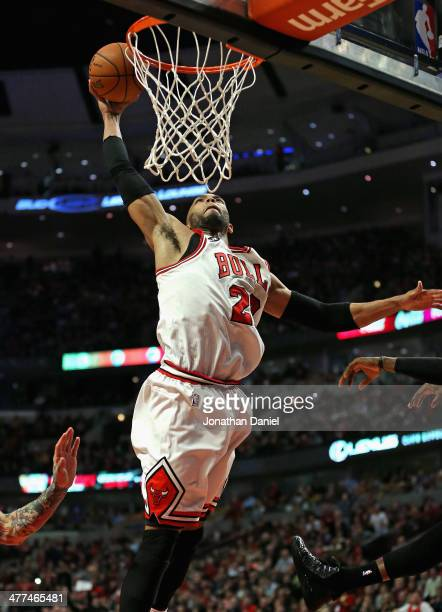 Taj Gibson of the Chicago Bulls goes up for a dunk against the Miami Heat at the United Center on March 9 2014 in Chicago Illinois The Bulls defeated...