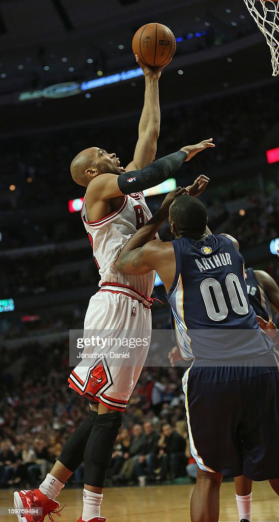 Taj Gibson #22 of the Chicago Bulls goes up for a dunk over Darrell Arthur #00 of the Memphis Grizzles at the United Center on January 19, 2013 in Chicago, Illinois. The Grizzlies defeated the Bulls 85-82 in overtime.