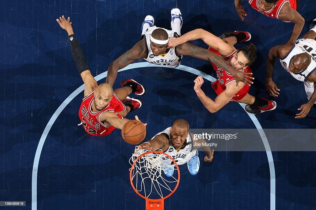 <a gi-track='captionPersonalityLinkClicked' href=/galleries/search?phrase=Taj+Gibson&family=editorial&specificpeople=4029461 ng-click='$event.stopPropagation()'>Taj Gibson</a> #22 of the Chicago Bulls goes up for a rebound against <a gi-track='captionPersonalityLinkClicked' href=/galleries/search?phrase=Marreese+Speights&family=editorial&specificpeople=4187263 ng-click='$event.stopPropagation()'>Marreese Speights</a> #5 of the Memphis Grizzlies on December 17, 2012 at FedExForum in Memphis, Tennessee.