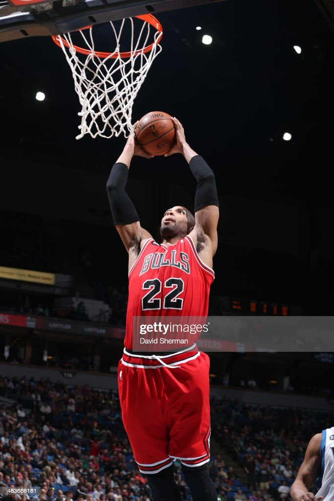 Taj Gibson #22 of the Chicago Bulls goes up for the dunk against the Minnesota Timberwolves during the game on April 9, 2014 at Target Center in Minneapolis, Minnesota.