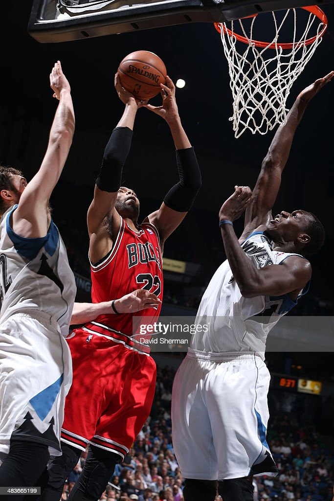 Taj Gibson #22 of the Chicago Bulls goes up with the ball against the Minnesota Timberwolves during the game on April 9, 2014 at Target Center in Minneapolis, Minnesota.