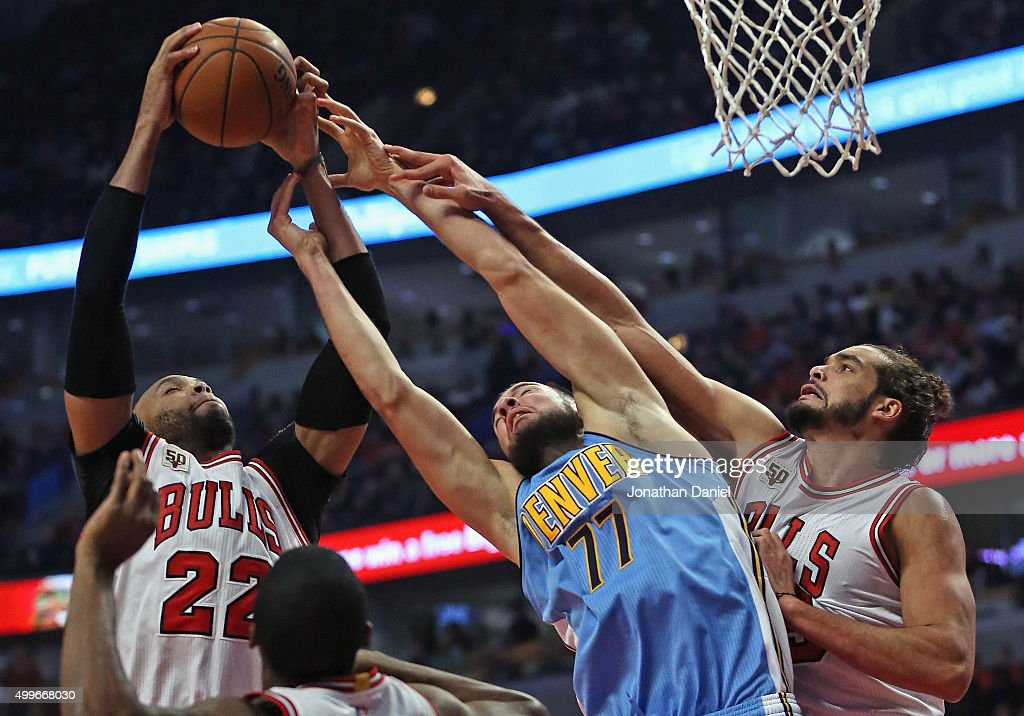 <a gi-track='captionPersonalityLinkClicked' href=/galleries/search?phrase=Taj+Gibson&family=editorial&specificpeople=4029461 ng-click='$event.stopPropagation()'>Taj Gibson</a> #22 of the Chicago Bulls grabs a rebound away from <a gi-track='captionPersonalityLinkClicked' href=/galleries/search?phrase=Joffrey+Lauvergne&family=editorial&specificpeople=6828069 ng-click='$event.stopPropagation()'>Joffrey Lauvergne</a> #77 of the Denver Nuggets as <a gi-track='captionPersonalityLinkClicked' href=/galleries/search?phrase=Joakim+Noah&family=editorial&specificpeople=699038 ng-click='$event.stopPropagation()'>Joakim Noah</a> #13 applies defensive pressure at the United Center on December 2, 2015 in Chicago, Illinois. Note to User: User expressly acknowledges and agrees that, by downloading and or using the photograph, User is consenting to the terms and conditions of the Getty Images License Agreement.