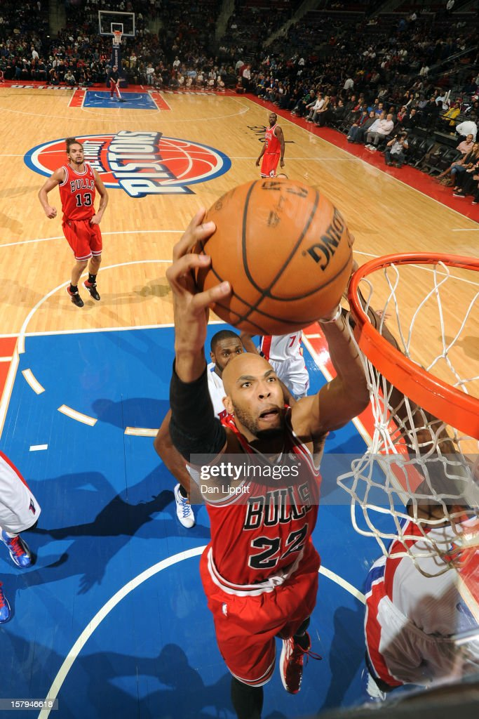<a gi-track='captionPersonalityLinkClicked' href=/galleries/search?phrase=Taj+Gibson&family=editorial&specificpeople=4029461 ng-click='$event.stopPropagation()'>Taj Gibson</a> #22 of the Chicago Bulls grabs the ball against the Detroit Pistons on December 7, 2012 at The Palace of Auburn Hills in Auburn Hills, Michigan.