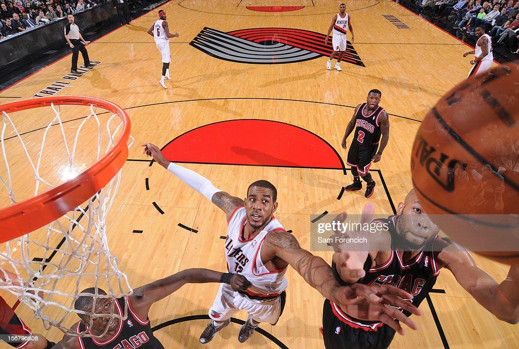 Taj Gibson #22 of the Chicago Bulls grabs the rebound against LaMarcus Aldridge #12 of the Portland Trail Blazers on November 18, 2012 at the Rose Garden Arena in Portland, Oregon.