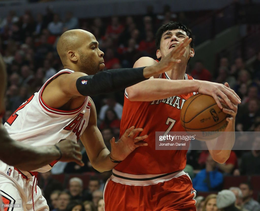 <a gi-track='captionPersonalityLinkClicked' href=/galleries/search?phrase=Taj+Gibson&family=editorial&specificpeople=4029461 ng-click='$event.stopPropagation()'>Taj Gibson</a> #22 of the Chicago Bulls guards <a gi-track='captionPersonalityLinkClicked' href=/galleries/search?phrase=Ersan+Ilyasova&family=editorial&specificpeople=557070 ng-click='$event.stopPropagation()'>Ersan Ilyasova</a> #7 of the Milwaukee Bucks at the United Center on January 9, 2013 in Chicago, Illinois.