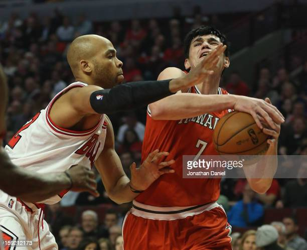 Taj Gibson of the Chicago Bulls guards Ersan Ilyasova of the Milwaukee Bucks at the United Center on January 9 2013 in Chicago Illinois NOTE TO USER...