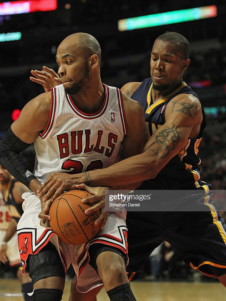 <a gi-track='captionPersonalityLinkClicked' href=/galleries/search?phrase=Taj+Gibson&family=editorial&specificpeople=4029461 ng-click='$event.stopPropagation()'>Taj Gibson</a> #22 of the Chicago Bulls hangs onto the ball as it is slapped by David West #21 of the Indiana Pacers at the United Center on December 20, 2011 in Chicago, Illinois. The Bulls defeated the Pacers 93-85.