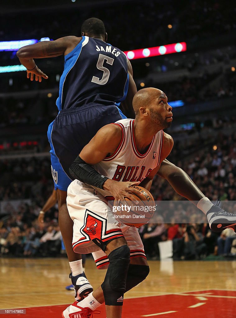 Taj Gibson #22 of the Chicago Bulls is fouled by Bernard James #5 of the Dallas Mavericks at the United Center on November 28, 2012 in Chicago, Illinois. The Bulls defeated the Mavericks 101-78.