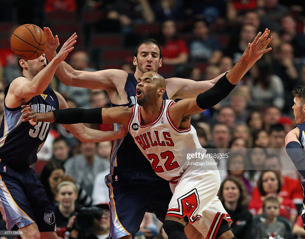 <a gi-track='captionPersonalityLinkClicked' href=/galleries/search?phrase=Taj+Gibson&family=editorial&specificpeople=4029461 ng-click='$event.stopPropagation()'>Taj Gibson</a> #22 of the Chicago Bulls is fouled by <a gi-track='captionPersonalityLinkClicked' href=/galleries/search?phrase=Kosta+Koufos&family=editorial&specificpeople=4216032 ng-click='$event.stopPropagation()'>Kosta Koufos</a> #41 of the Memphis Grizzlies as he moves against <a gi-track='captionPersonalityLinkClicked' href=/galleries/search?phrase=Jon+Leuer&family=editorial&specificpeople=4630766 ng-click='$event.stopPropagation()'>Jon Leuer</a> #30 at the United Center on March 7, 2014 in Chicago, Illinois.