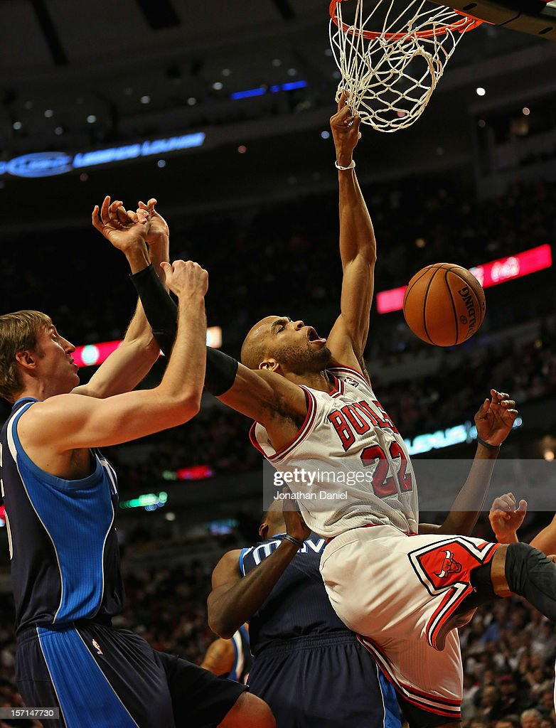 <a gi-track='captionPersonalityLinkClicked' href=/galleries/search?phrase=Taj+Gibson&family=editorial&specificpeople=4029461 ng-click='$event.stopPropagation()'>Taj Gibson</a> #22 of the Chicago Bulls is fouled by <a gi-track='captionPersonalityLinkClicked' href=/galleries/search?phrase=Troy+Murphy+-+Basketball+Player&family=editorial&specificpeople=201794 ng-click='$event.stopPropagation()'>Troy Murphy</a> #6 of the Dallas Mavericks at the United Center on November 28, 2012 in Chicago, Illinois. The Bulls defeated the Mavericks 101-78.