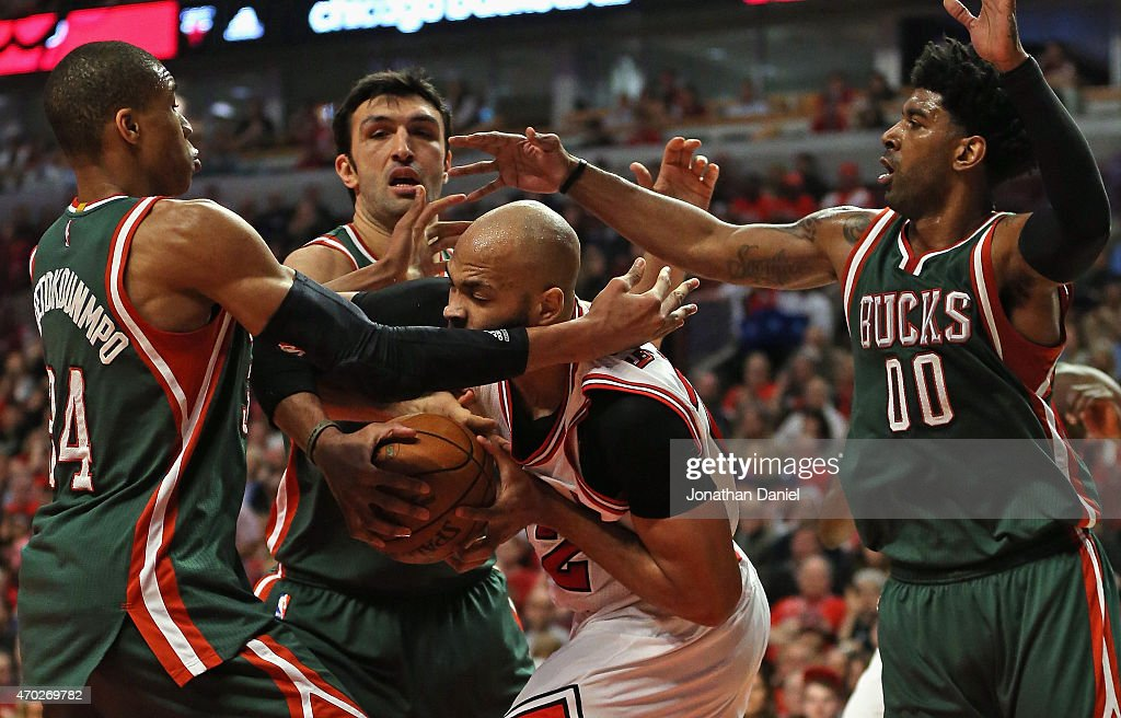Taj Gibson #22 of the Chicago Bulls is pressured by Giannis Antetokounmpo #34, Zaza Pachulia #27 and O.J. Mayo #00 of the Milwaukee Bucks during the first round of the 2015 NBA Playoffs at the United Center on April 18, 2015 in Chicago, Illinois.