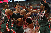 Taj Gibson of the Chicago Bulls is pressured by Giannis Antetokounmpo Zaza Pachulia and OJ Mayo of the Milwaukee Bucks during the first round of the...