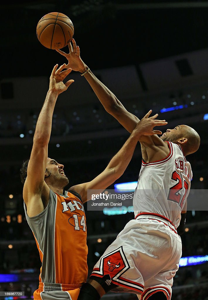 Taj Gibson #22 of the Chicago Bulls knocks the ball away from Luis Scola #32 of the Phoenix Suns at the United Center on January 12, 2013 in Chicago, Illinois.