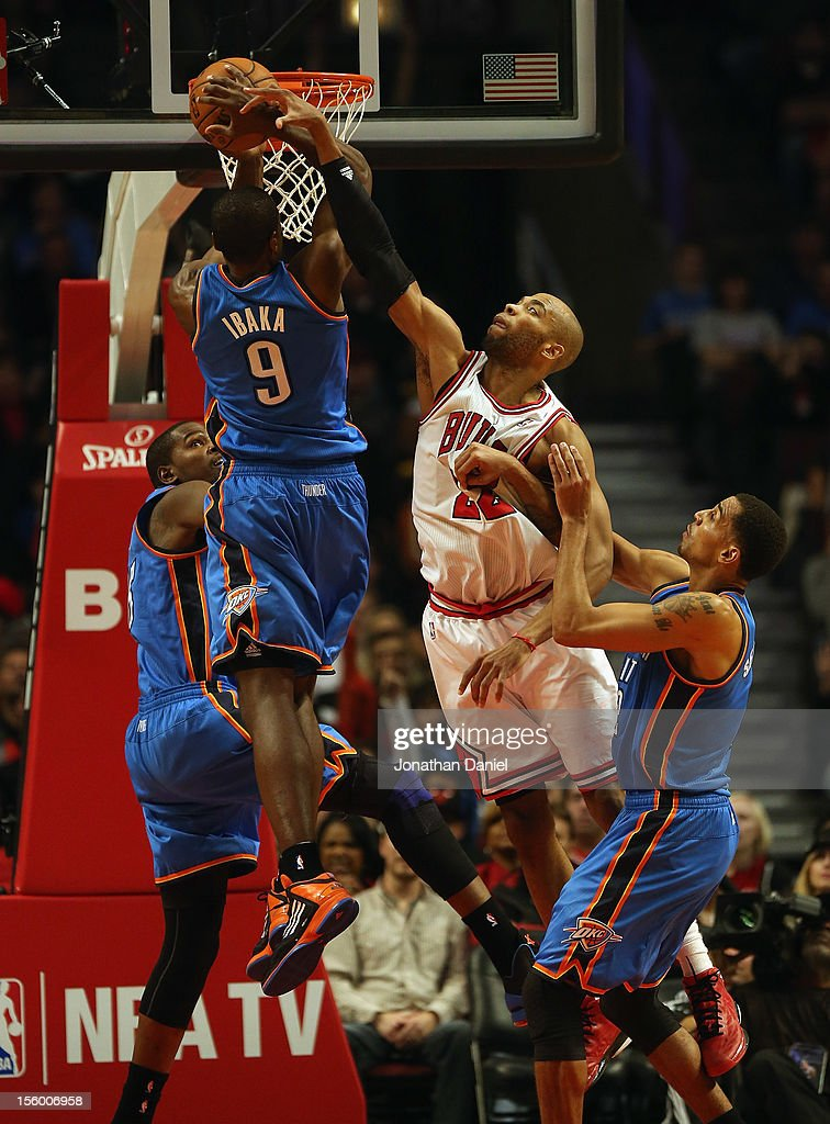 Taj Gibson #22 of the Chicago Bulls leaps to block a shot by Serge Ibaka #9 of the Oklahoma City Thunder at the United Center on November 8, 2012 in Chicago, Illinois. The Thunder defeated the Bulls 97-91.