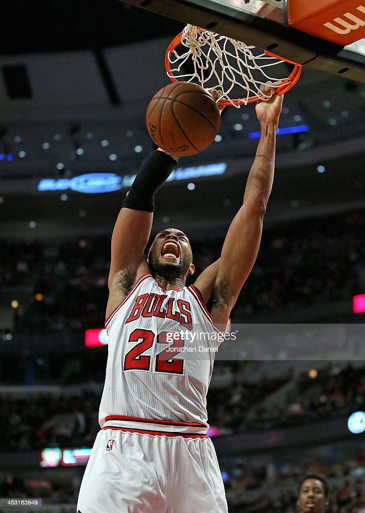 <a gi-track='captionPersonalityLinkClicked' href=/galleries/search?phrase=Taj+Gibson&family=editorial&specificpeople=4029461 ng-click='$event.stopPropagation()'>Taj Gibson</a> #22 of the Chicago Bulls lets out a scream as he dunks against the New Orleans Pelicans at the United Center on December 2, 2013 in Chicago, Illinois.