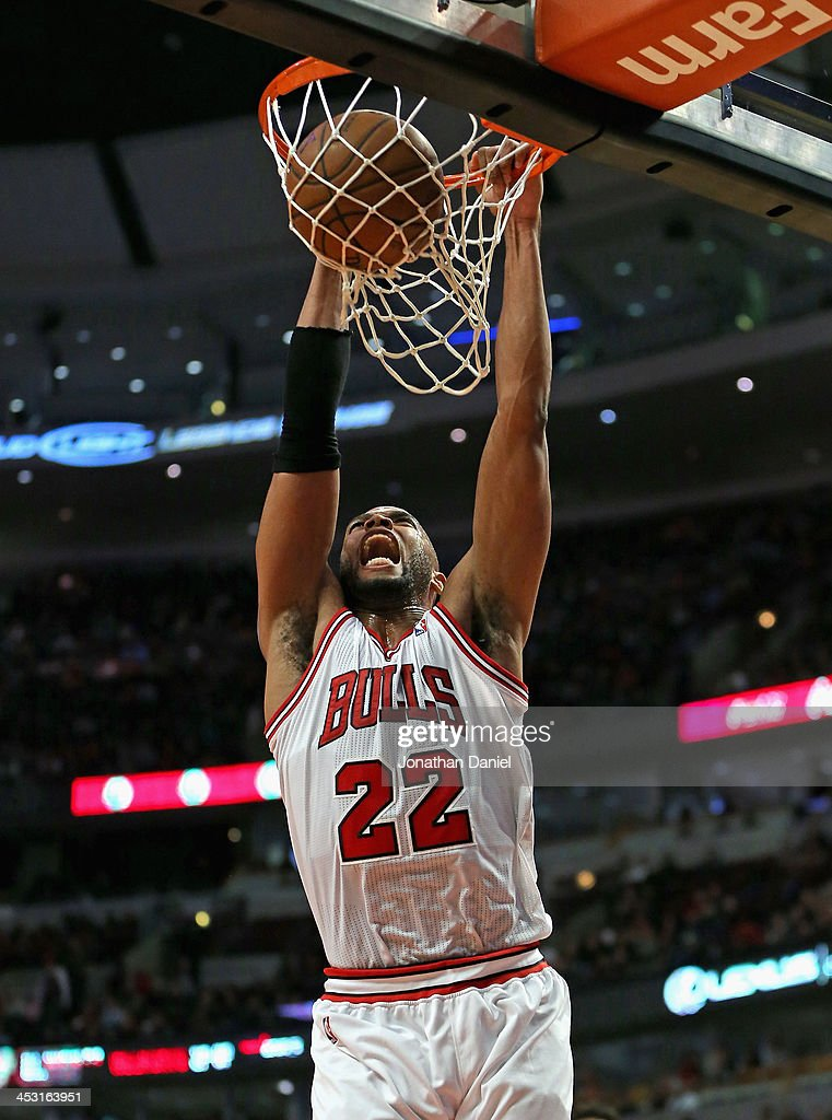 Taj Gibson #22 of the Chicago Bulls lets out a scream as he dunks against the New Orleans Pelicans at the United Center on December 2, 2013 in Chicago, Illinois.